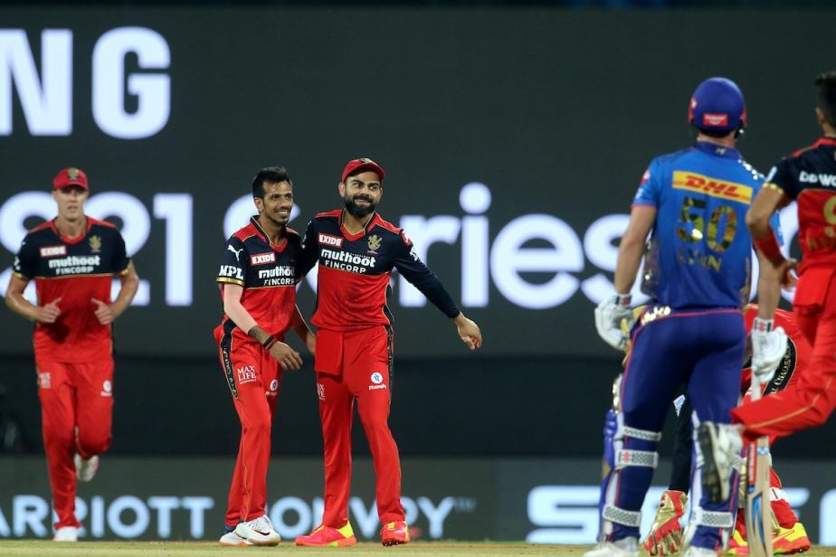 In Pics, IPL 2021: Harshal Patel's Fifer Takes RCB to Win Against MI