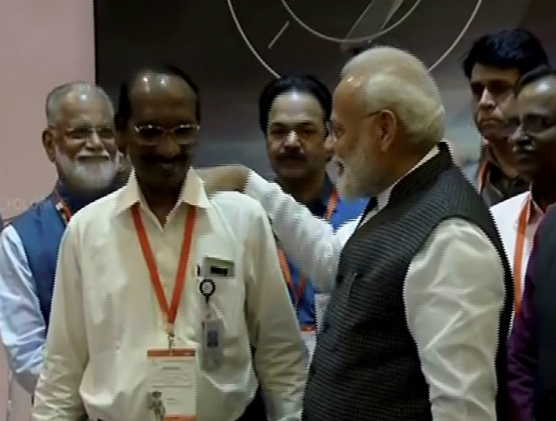 Prime Minister Narendra Modi interacts with ISRO chairman K Sivan after connection with the Vikram lander was lost during soft landing of Chandrayaan 2 on lunar surface, in Bengaluru on September 7, 2019. (PTI Photo)