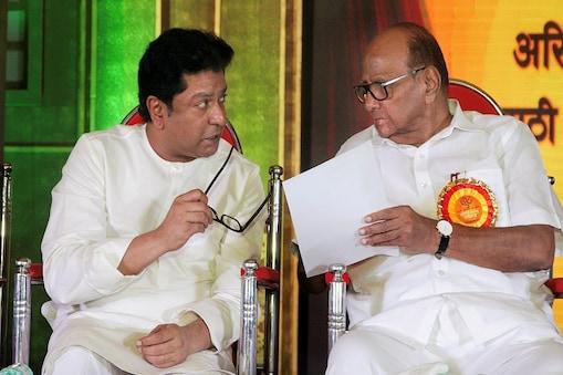 Mumbai: NCP chief Sharad Pawar with MNS President Raj Thackeray during the opening ceremony of  98th Akhil Bharatiya Marathi Natya Sammelan in Mulund, Mumbai on Wednesday night, June 13, 2018. (PTI Photo)(PTI6_14_2018_000038B)