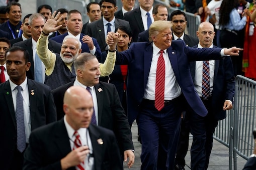 """Houston: President Donald Trump and Indian Prime Minister Narendra Modi walk around NRG Stadium waving to the crowd during the """"Howdy Modi: Shared Dreams, Bright Futures"""" event, Sunday, Sept. 22, 2019, in Houston. AP/PTI Photo(AP9_23_2019_000011B)"""