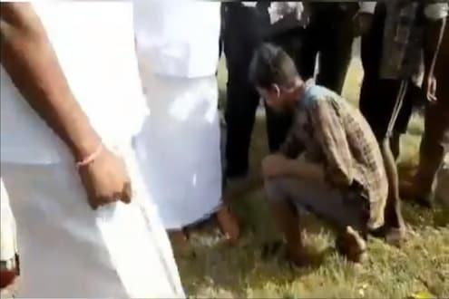 VIDEO : 'ए इकडे ये, माझ्या पायातले बूट काढ' आदिवासी मुलाला बोलावून घेऊन वनमंत्र्यांची मुजोरी