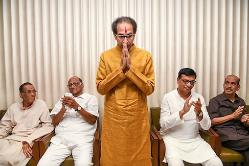 Mumbai: Shiv Sena President Uddhav Thackeray gestures after he was chosen as the nominee for Maharashtra chief minister's post by Shiv Sena-NCP-Congress alliance, during a meeting in Mumbai, Tuesday, Nov. 26, 2019. NCP chief Sharad Pawar and other leaders are also seen. (PTI Photo)  (PTI11_26_2019_000222B)