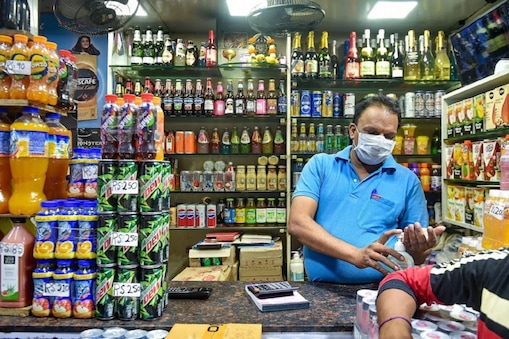Mumbai: A shopkeeper wears a mask and sanitize his hands in the wake of deadly coronavirus, at Crawford market in Mumbai, Wednesday, March 18, 2020. (PTI Photo/Mitesh Bhuvad) (PTI18-03-2020_000222B)