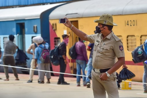 Bengaluru: Migrant people wait in a queue at Chikkabanavara railway station to board a special train for their native places in Uttar Pradesh, amid ongoing COVID-19 lockdown, in Bengaluru, Friday, May 8, 2020. (PTI Photo/Shailendra Bhojak) (PTI08-05-2020_000202B) *** Local Caption ***