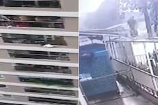 VIDEO - 12व्या मजल्यावरून कोसळली चिमुकली; सुपरहिरोसारखं डिलीव्हरी बॉयनं केलं कॅच