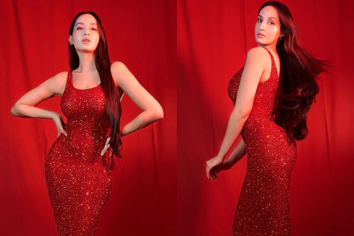 नोरा फतेहीचा हा लेटेस्ट लूक पाहून तिच्या चाहत्यांनी कमेंट्सचा वर्षाव केला आहे. तर या चंदेरी ड्रेस मध्ये ती अतिशय ग्लँमरस दिसत आहे.