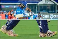IPL 2021 : बुटांवर 'स्पेशल मेसेज' लिहून रोहित उतरला मैदानात, काय आहे अर्थ?