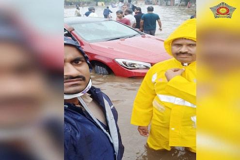 मुंबई पोलिसांना सॅल्यूट! 4 फूट पाण्यात कारमध्ये अडकलेल्या तिघांची सुखरूप सुटका
