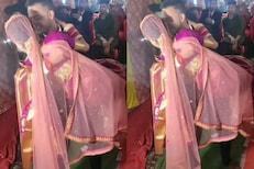 VIDEO : भर मंडपात उफाळून आलं नवरदेवाचं प्रेम; नवरीला घेतलं उचलून अन्...