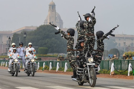BSF 'Daredevils' motorcycle stunt team during the rehearsals for the upcoming Republic Day parade at Rajpath in New Delhi on Monday. (PTI)