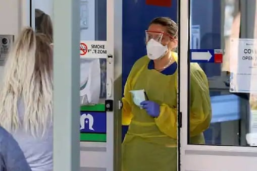 A nurse speaks with patients at the door of a new coronavirus disease (COVID-19) clinic opening at Mount Barker Hospital in Adelaide, Australia. (Reuters)