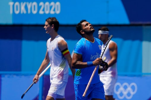 India's Harmanpreet Singh reacts after scoring during a men's field hockey semi-final match against Belgium at the 2020 Summer Olympics, Tuesday, Aug. 3, 2021, in Tokyo, Japan. (AP Photo/John Locher)