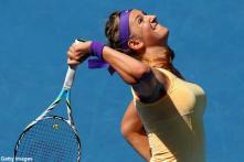 Azarenka blanks Vesnina to reach quarters
