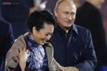 Vladimir Putin's gallantry upstages Chinese host at APEC summit