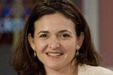Facebook names 1st woman, Sandberg, to board