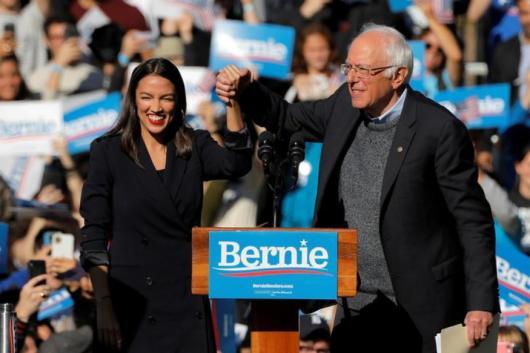 U.S. Rep. Alexandria Ocasio-Cortez (D-NY) introduces Democratic 2020 U.S. presidential candidate and U.S. Senator Bernie Sanders (I-VT) during the