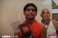 Nithyananda's surrender evokes mixed response