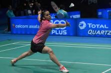 Saina seals a semifinal spot, Sindhu crashes out at Malaysia Open