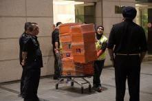 Cash-Filled Designer Handbags Seized in Raids on Malaysia's Najib