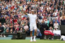 Federer storms into Wimbledon second round