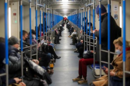 Commuters travel in a metro train during a partial lockdown in Moscow, Russia, on Thursday. (Reuters)