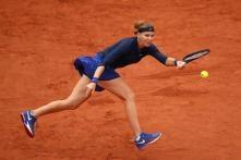 Safarova Dodges Rain to Ease Into Second Round