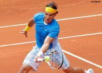Nadal, Federer reach Madrid semis