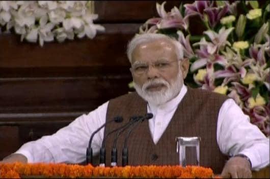 Narendra Modi addresses NDA workers in New Delhi on Saturday.