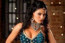 Veena Malik plays double role in 'Daal Mein...'