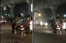 'Where's the Helmet?': Delhi Couple's Filmy Kissing Stunt on Bike Leaves Netizens Unimpressed
