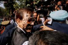 Photos outside Supreme Court: A shirtless lawyer throws black ink on Subrata Roy, Chairman of Sahara India Pariwar