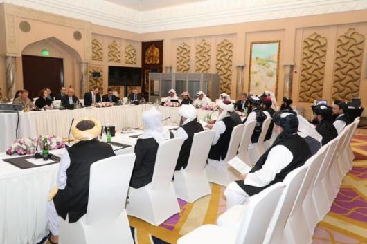 Undated handout picture of U.S., Taliban and Qatar officials Talk. Qatari Foreign Ministry/Handout via REUTERS