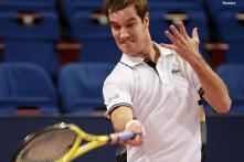 Gasquet wins but bumps into Federer in Paris