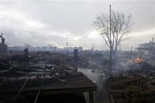 Superstorm Sandy: At least 21 people die