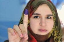 Joyful Libyans brave violence to grasp free vote