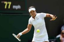 Li Na, Venus Williams advance to third round at Wimbledon