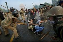 Watch: Delhi policemen attack anti-rape protesters