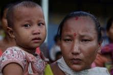 Assam still tense as Gogoi meets riot victims