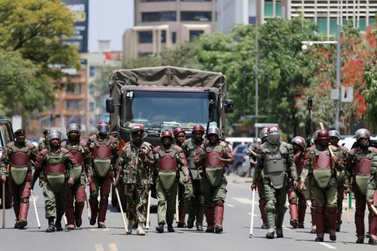 Riot policemen walk along a street in an attempt to disperse supporters of Kenyan opposition National Super Alliance (NASA) coalition, during a protest along a street in Nairobi, Kenya. Image: Reuters