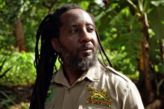 Rastafarian Ali Nansolo stands in a banana grove at his home near Zomba, Malawi, January 22, 2020. (Reuters)