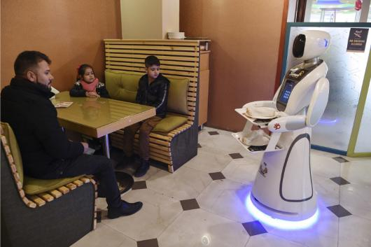A waitress robot named Timea delivers food to customers at a Times Fast Food restaurant in Kabul.  (Image: AFP Relaxnews)