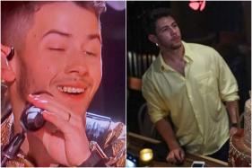 Nick Jonas Fans Can't Stop Stanning Over Food Stuck in His Teeth During Grammy Gig