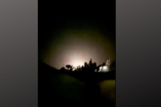An explosion is seen following missiles landing at what is believed to be Ain al-Asad Air Base in Iraq, in this still image taken from a video shot on January 8, 2020. (Iran Press/Handout via Reuters)