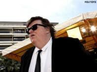 Michael Moore targets capitalism at Venice film fest