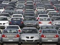 General Motors cuts jobs, dealers jittery