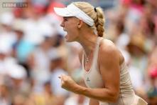Caroline Wozniacki outlasts Maria Sharapova, moves into US Open quarters