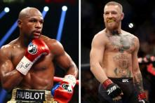 MMA Champion McGregor Signs Deal For Mayweather Bout