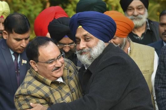 BJP President JP Nadda hugs SAD chief Sukhbir Singh Badal in New Delhi on Wednesday. (PTI)