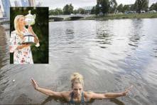 Angelique Kerber celebrates Australian Open win with river dip