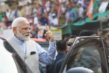 PHOTOS| PM Narendra Modi Casts His Vote in Ahmedabad